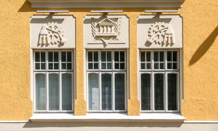 Foto de Bas-reliefs on the facade of the yellow house, Kuopio, Northern Savonia, Finland - Imagen libre de derechos