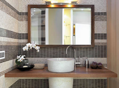 detail of furniture for top washbasin in  the modern bahtroom and larg mirror with wood frame