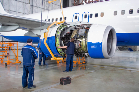 Foto de Replacing the engine on the airplane, working people. Concept maintenance of aircraft - Imagen libre de derechos