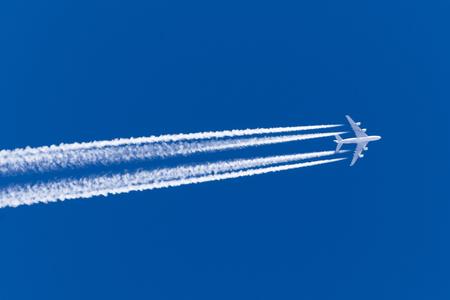 Foto de Huge airplane big four engines aviation airport contrail clouds - Imagen libre de derechos