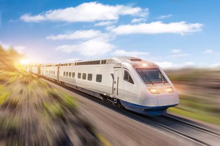 Foto de High speed train rides at high speed at the railway station in the city - Imagen libre de derechos