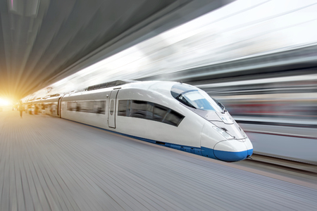 Photo pour Train rides at high speed at the railway station in the city. - image libre de droit