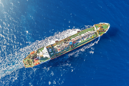 Photo for Ship, with bulk cargo, sails in the blue sea. Aerial view - Royalty Free Image