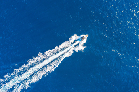 Photo for Boat launch at high speed floats in the Mediterranean, aerial top view - Royalty Free Image
