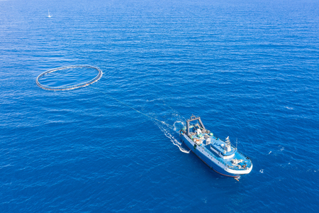 Photo pour Fishing boat with special equipment for fishing, fish frame sails in the Mediterranean sea - image libre de droit
