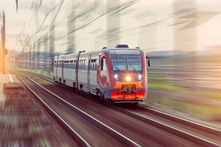Photo pour Passenger diesel train travels by rail motion blur effect. - image libre de droit