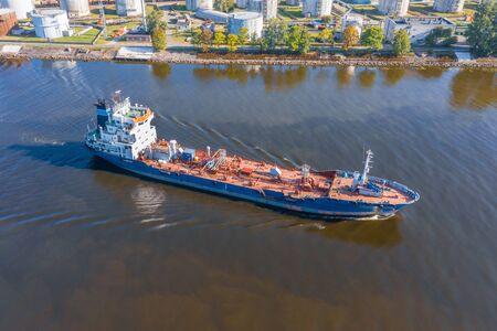 Photo for Aerial view tanker ship with liquid bulk cargo is sailing in channel water - Royalty Free Image