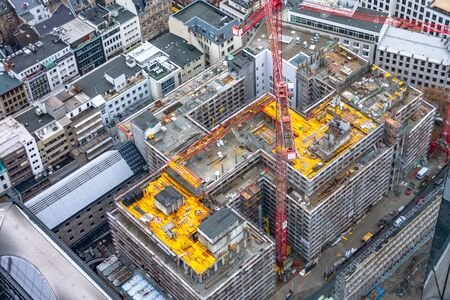 Photo pour Construction site with cranes among other urban other houses. Construction workers are building. Aerial view. Top view. - image libre de droit