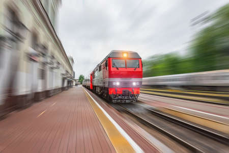 Photo pour Diesel locomotive with a passenger train with a wagon rushes along the railway - image libre de droit