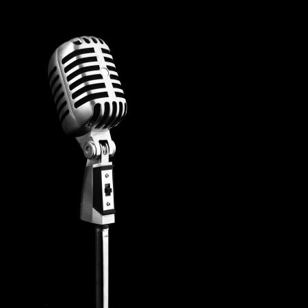 metal vintage microphone on black background