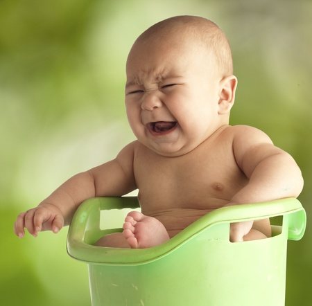 little baby having a bath on a tub outdoor