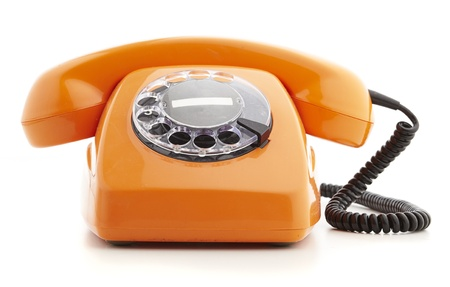 orange vintage telephone isolated on white