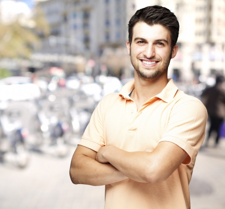 Photo for young man smiling against a street background - Royalty Free Image