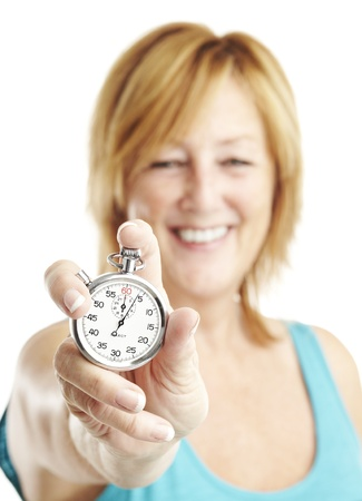 portrait of middle aged woman holding stopwatch over white