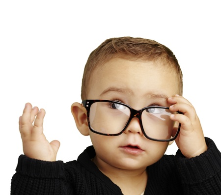 young boy wearing glasses and looking up against a white background