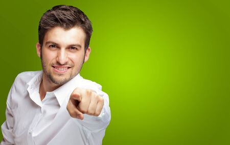 Portrait Of An Businessman Pointing Finger Isolated On Green Background