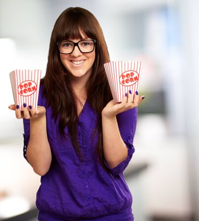 Casual Woman Holding Popcorn Container, Indoor