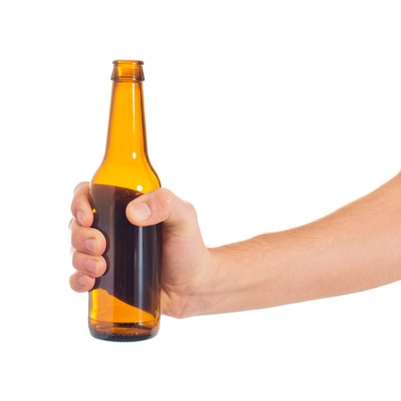 Close-up Of Hand Holding Empty Beer Bottle On White Backgroundの写真素材