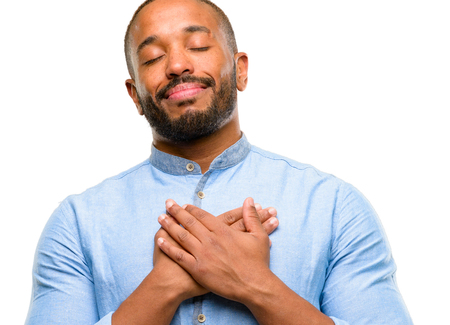African american man with beard with hands in heart, expressing love and health concept isolated over white background