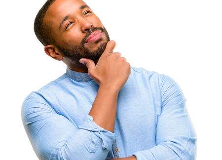 African american man with beard thinking and looking up expressing doubt and wonder isolated over white background
