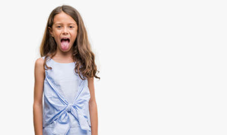 Photo pour Brunette hispanic girl sticking tongue out happy with funny expression. Emotion concept. - image libre de droit