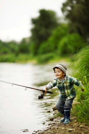Photo pour a little boy fishing - image libre de droit