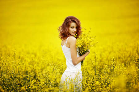 young beautiful girl in the fieldの写真素材