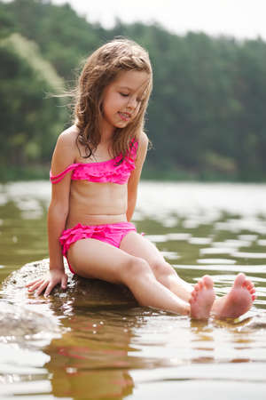 Foto de cute happy little girls in sumer lake - Imagen libre de derechos