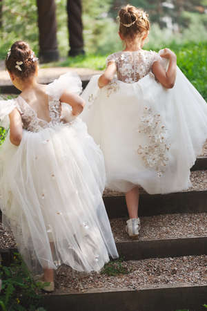 Photo pour happy beautiful girls with white wedding dresses - image libre de droit
