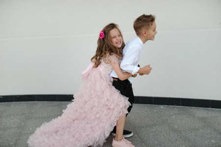 Photo for young happy boy and girl together outside - Royalty Free Image