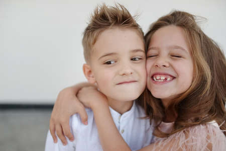Photo pour young happy boy and girl together outside - image libre de droit