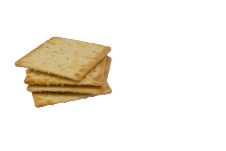 Foto de Cracker biscuits over white background. Selective focus - Imagen libre de derechos