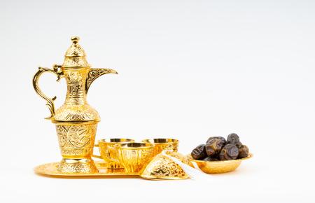 Photo pour Premium dates and arabic coffee set on white background. Selective focus, copy space and Ramadan Kareem concept - image libre de droit