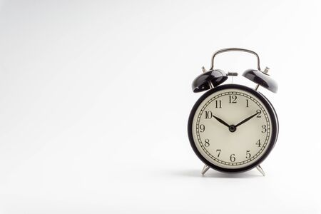 Photo for Alarm Clock isolated on white background with selective focus and crop fragment - Royalty Free Image