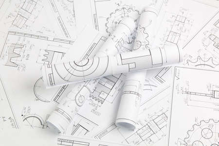 Photo pour paper engineering drawings of industrial parts and mechanisms - image libre de droit