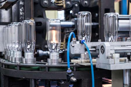 Plastic bottle manufacture, blow moulding production line