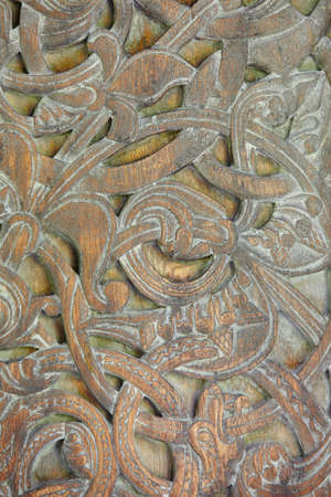 Norwegian ancient wooden carving. Nature forms. Norway. Vertical