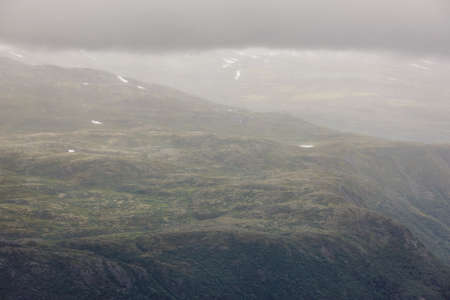 Norwegian mountain landscape on a cloudy day. Fog