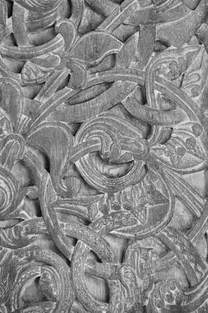 Norwegian ancient wooden carving. Nature forms. Vertical