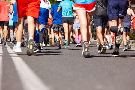 Photo for Marathon runners on the street. Healthy lifestyle. Urban athlete endurance - Royalty Free Image