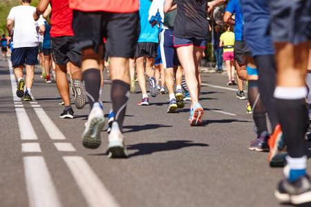 Foto de Marathon runners on the street. Healthy lifestyle. Athlete endurance - Imagen libre de derechos