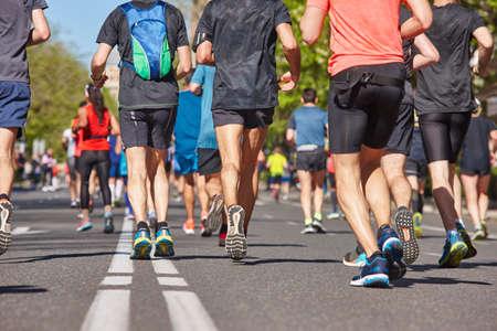 Photo pour Marathon runners on the street. Healthy lifestyle. Urban athlete endurance - image libre de droit