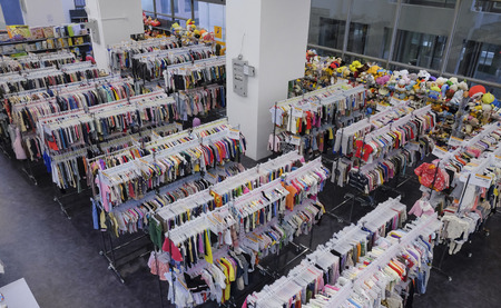 KUALA LUMPUR, MALAYSIA - JANUARY 21, 2017 : Clothing store, many rows with pants and t-shirts, variety of sizes.
