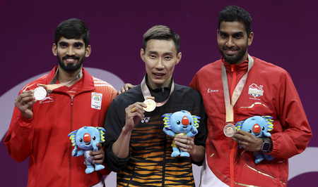 GOLD COAST, AUSTRALIA - APRIL 15, 2018 : Gold medalist Lee Chong Wei (C) of Malaysia in the men's singles during Gold Coast 2018 Commonwealth Games at Carrara Sports and Leisure Centre.