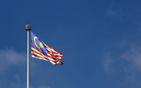 Photo pour Malaysia flag also known as Jalur Gemilang waving with the blue sky background. In conjunction of Independence Day or Merdeka Day celebration on 31 August and Hari Malaysia on 16 September. - image libre de droit