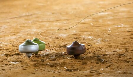Photo pour Traditional game called gasing or tops spinning. Gasing is Malaysia popular heritage game for tourist in tourism industries. - image libre de droit