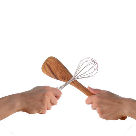 Two hands fighting with kitchen tools