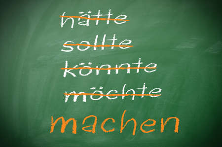 Texture of a blackboard with German Do it concept