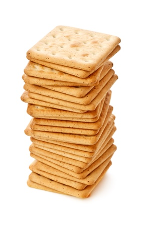 salty crackers pile isolated on white background
