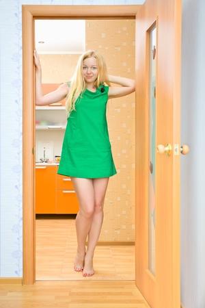 beautiful blond girl in doorway at home